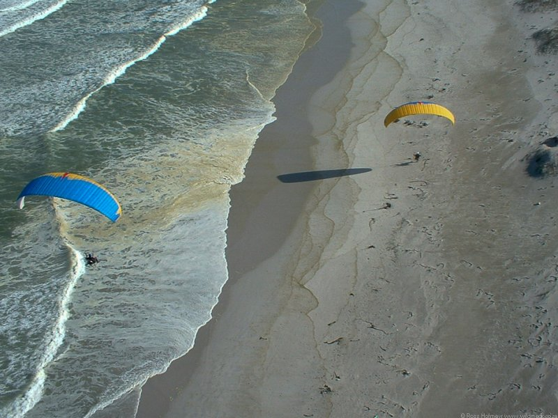 Liam and I flying low along the deserted beach.  Photo: Hannes Jansen
