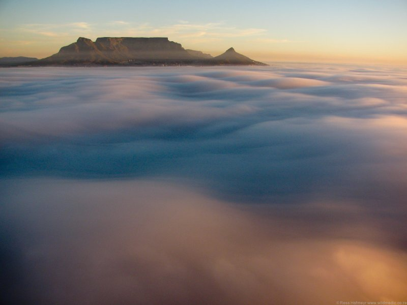 Table Mountain above the fog at sunset