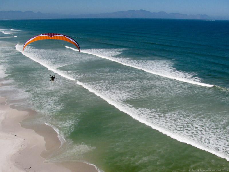John flying low along the beach
